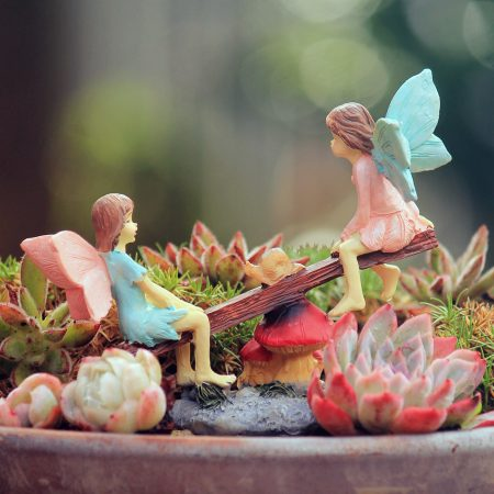 fairies on seesaw figurine