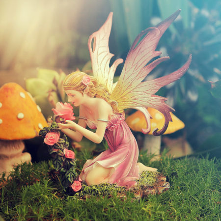 fairy smelling flowers figurine