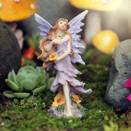 purple fairy figurine